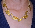 gold and cord necklace